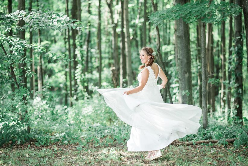 bride twirling in wedding dress