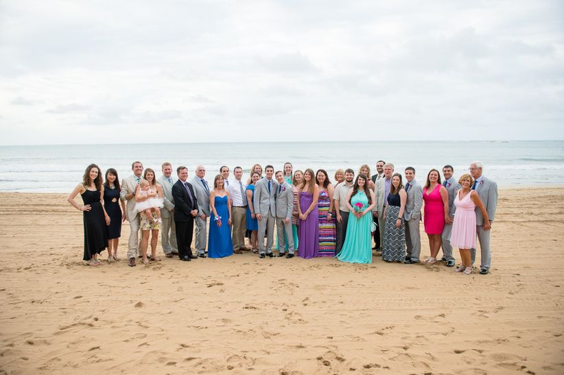 wedding guests group photo beach