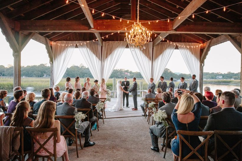 wedding ceremony in pavilion with chandelier
