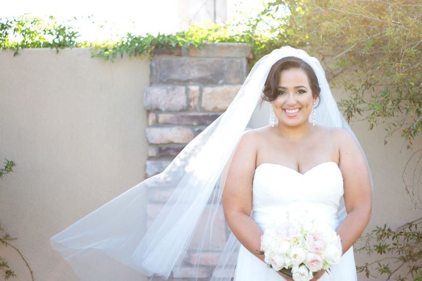 bride with mid-length veil in wind