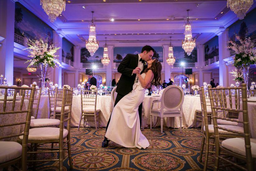 couple kissing in hotel ballroom