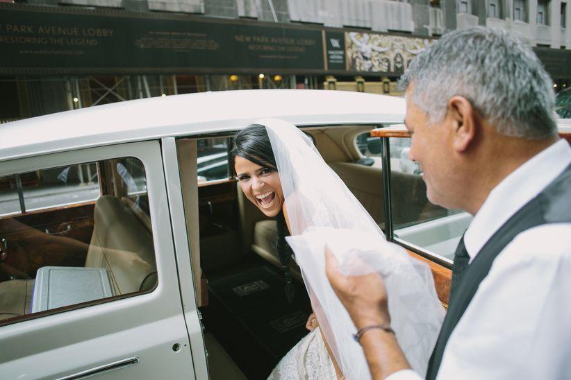 bride entering classic car limo