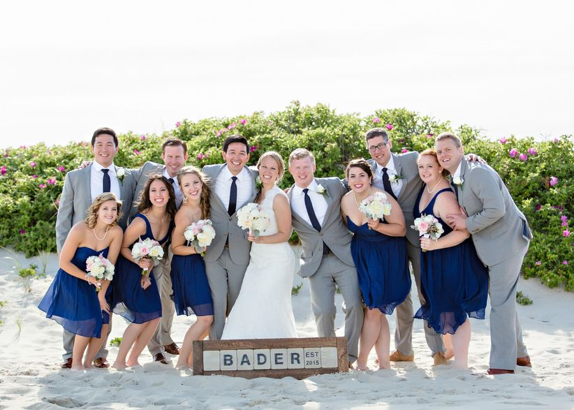 beach wedding party with last name sign