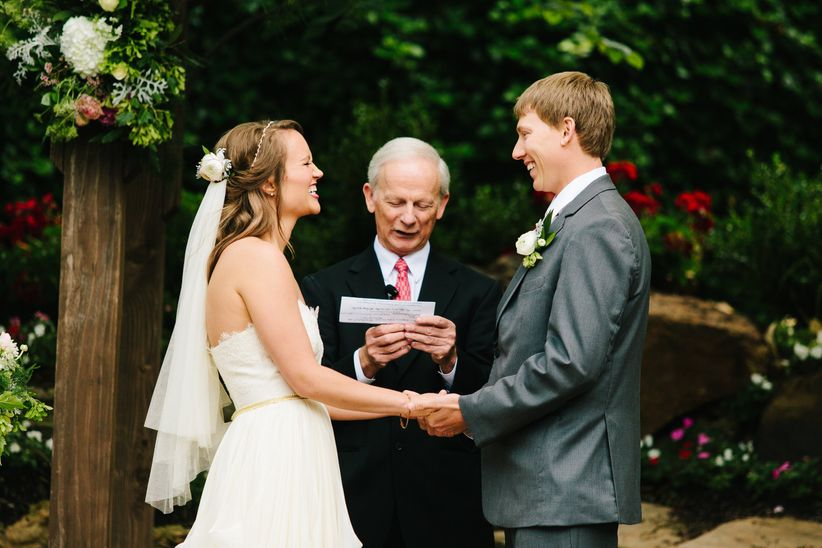 Finding the ceremony officiant weddingwire couple laughing during wedding ceremony junglespirit Choice Image