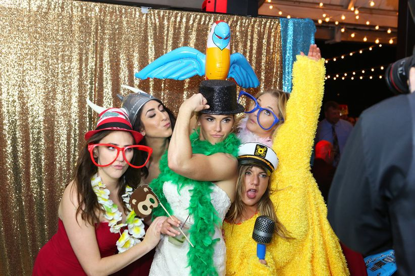 bride and guests in photo booth