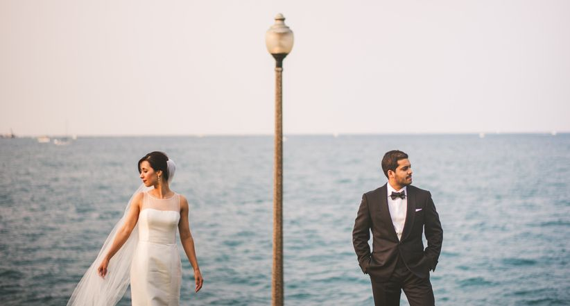 couple standing side by side with ocean backdrop
