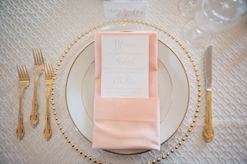 wedding place setting with peach napkin