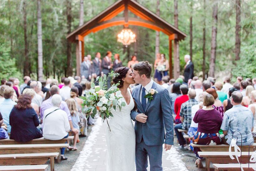 How to plan your wedding in 6 months weddingwire couple kissing during recessional junglespirit Choice Image