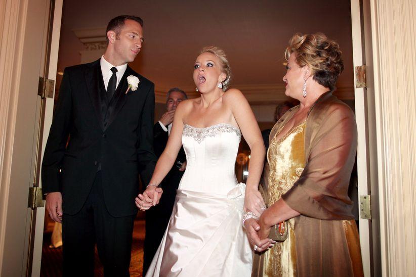 surprised bride entering reception