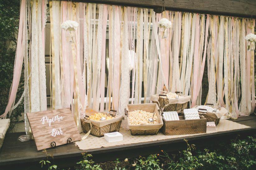 wedding popcorn bar with ribbon backdrop