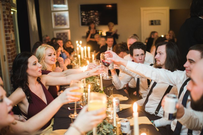 guests toast at wedding reception