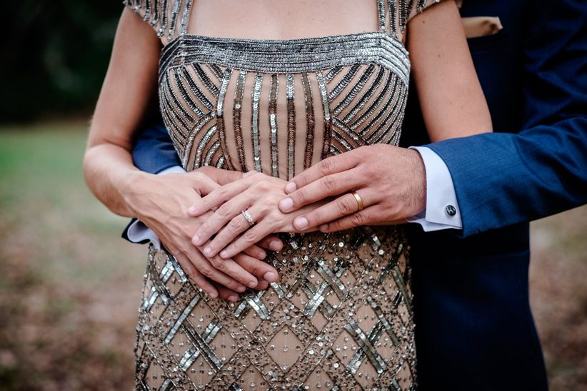 wedding rings couple holding hands