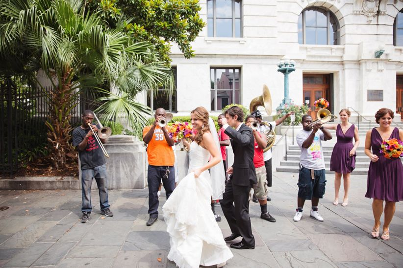 10 unique wedding music ideas that will def rock the house weddingwire wedding music ideas couple second line parade junglespirit Image collections