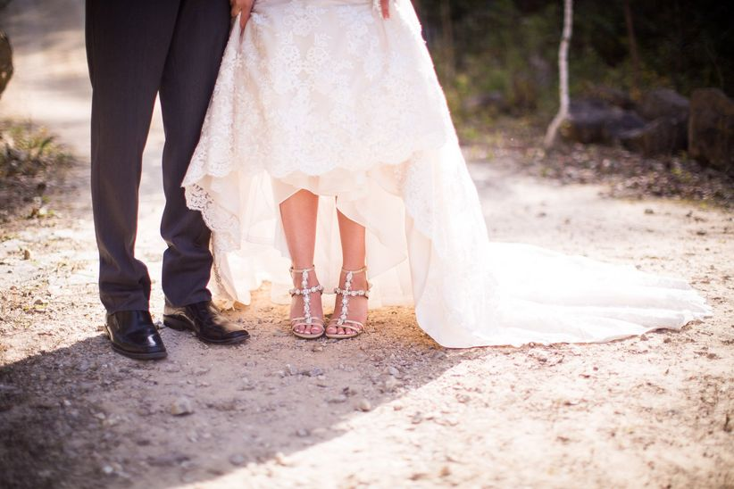 wedding couple showing shoes