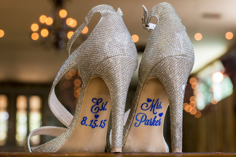 wedding shoes with blue lettering on soles