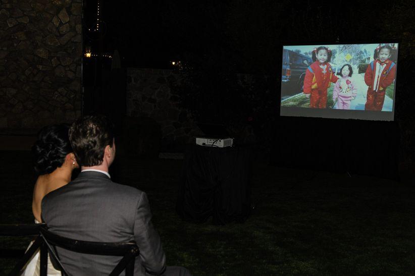 couple watching wedding photo slideshow