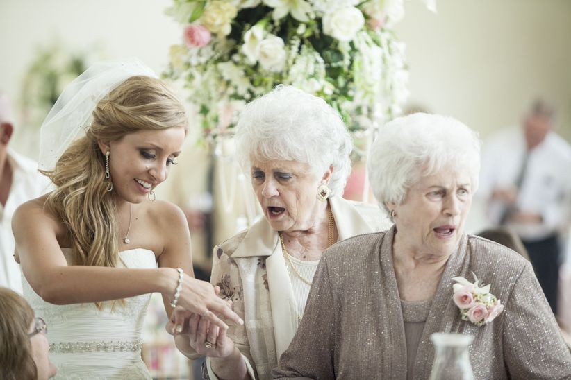 bride and grandmother looking at rings
