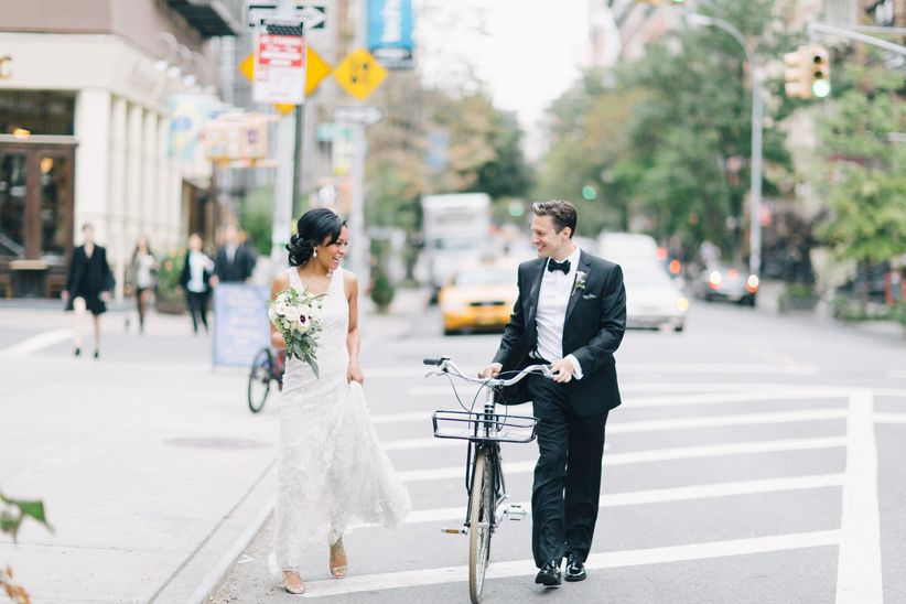 couple walking city bike