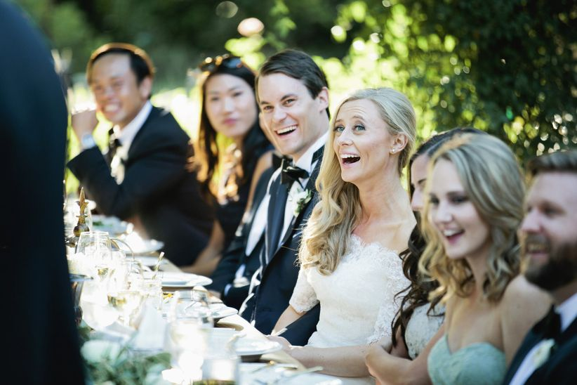 couple during toast laughing