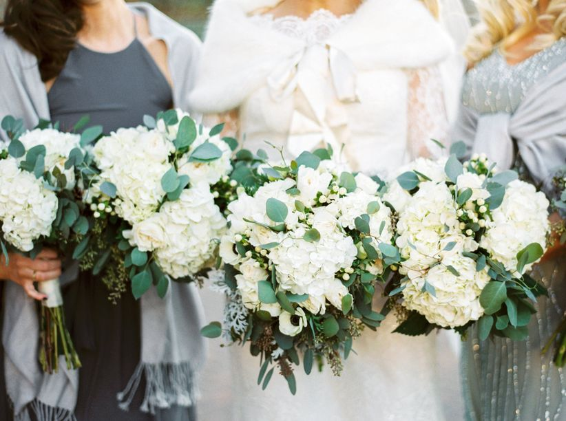 bridesmaids with winter white bouquets