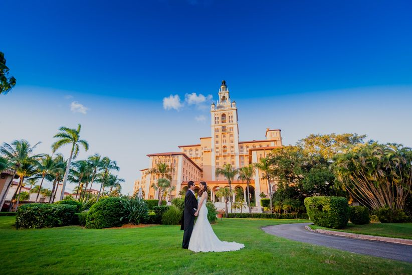 couple with wedding hotel backdrop