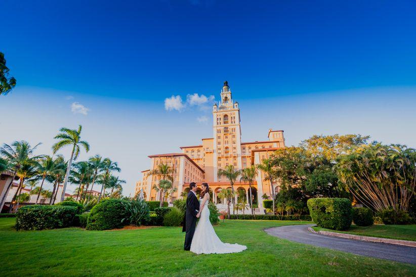 couple with wedding hotel backdrop