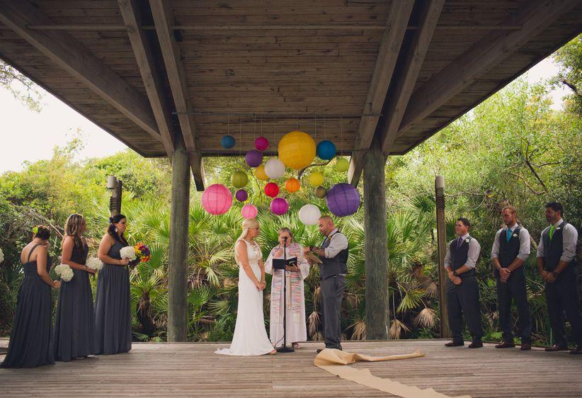 couple reciting wedding vows rainbow lanterns