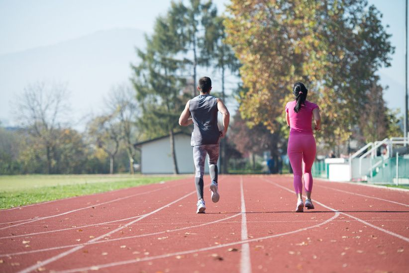 couple running on track