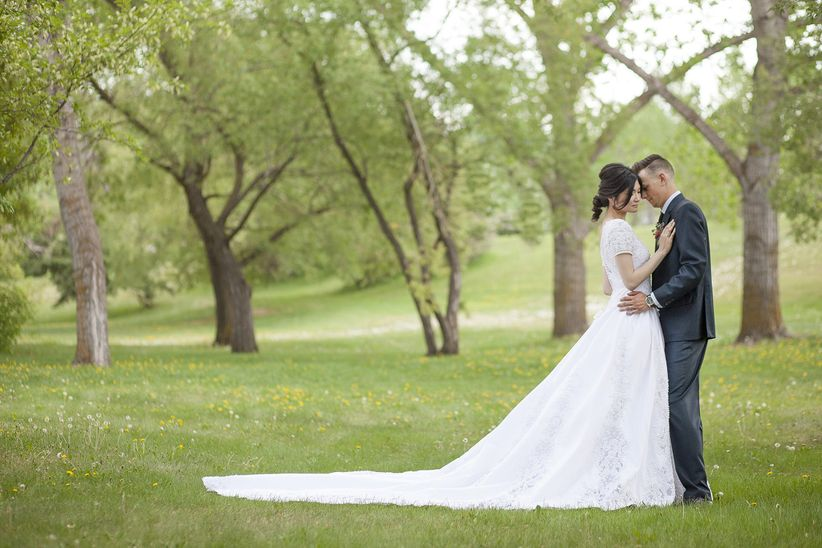 bride and groom formal portrait outdoor ball gown and suit
