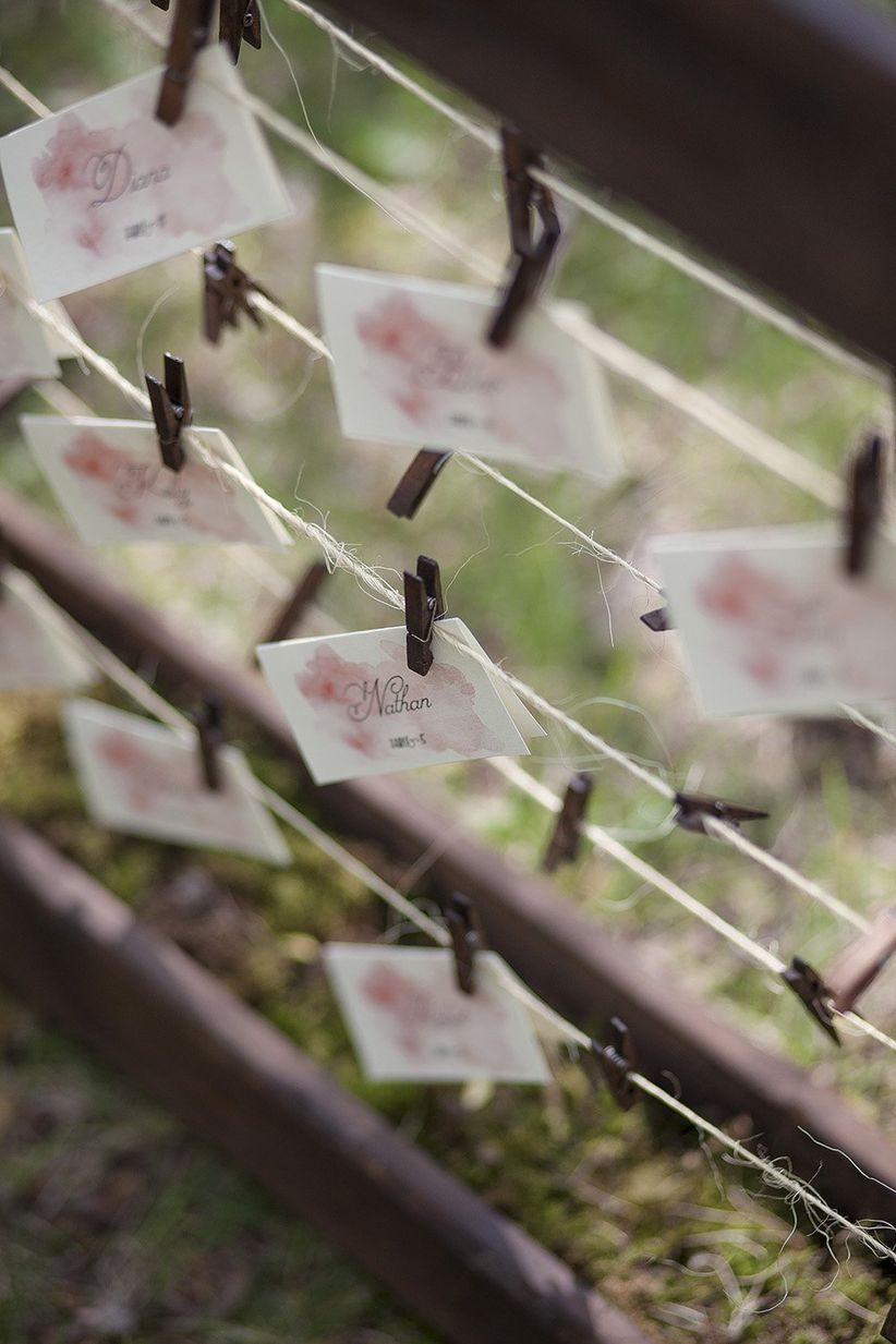 escort cards outdoor display hung by clothespins