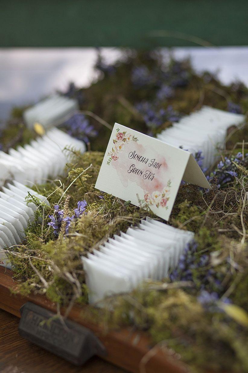 vintage-inspired escort cards displayed in wild flowers