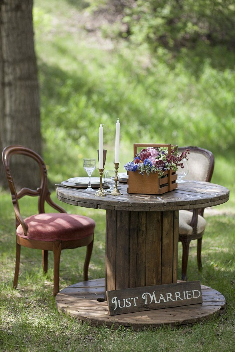 vintage outdoor wooden sweetheart table floral centerpiece in basket
