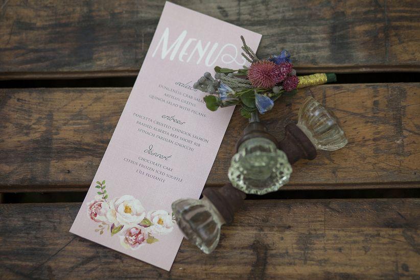 close up pastel pink menu vintage decorative wine corks and boutonniere