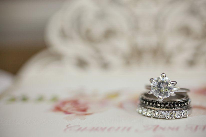 close up solitaire engagement ring men's wedding ring and women's wedding ring