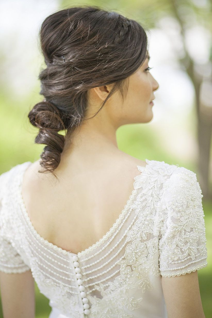 bride in vintage wedding down with twisted updo with braids