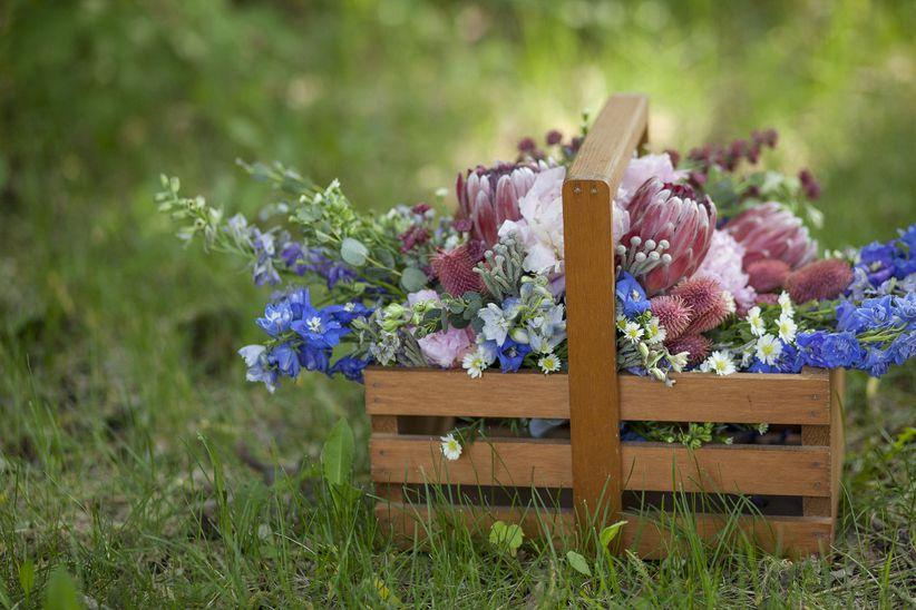 bouquet of wildflowers in wooden basket