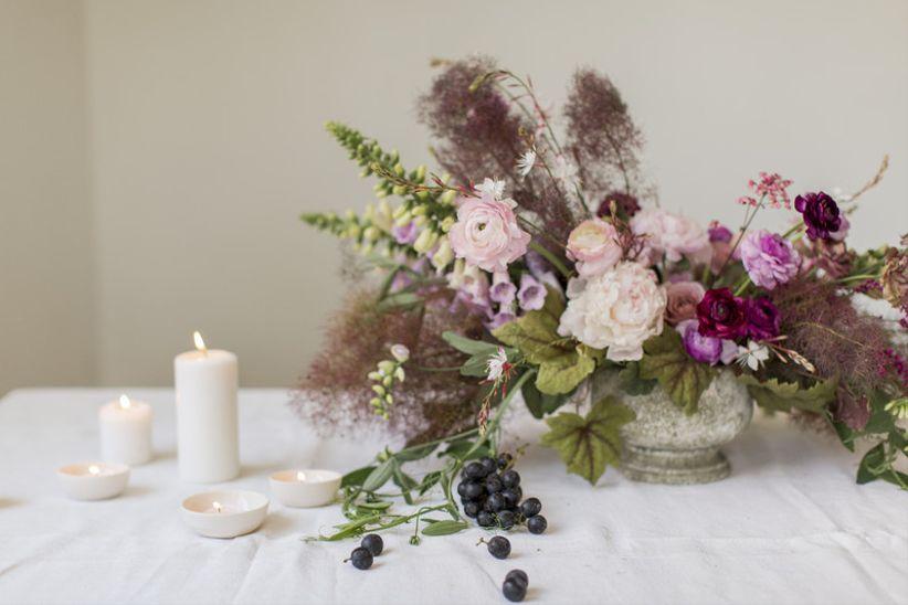 bohemian wedding centerpiece with purple flowers and greenery