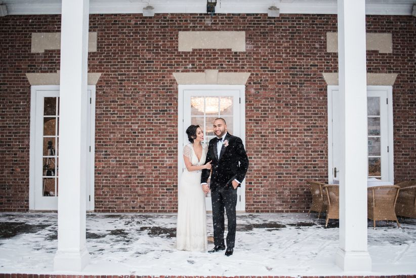 couple with snow wedding
