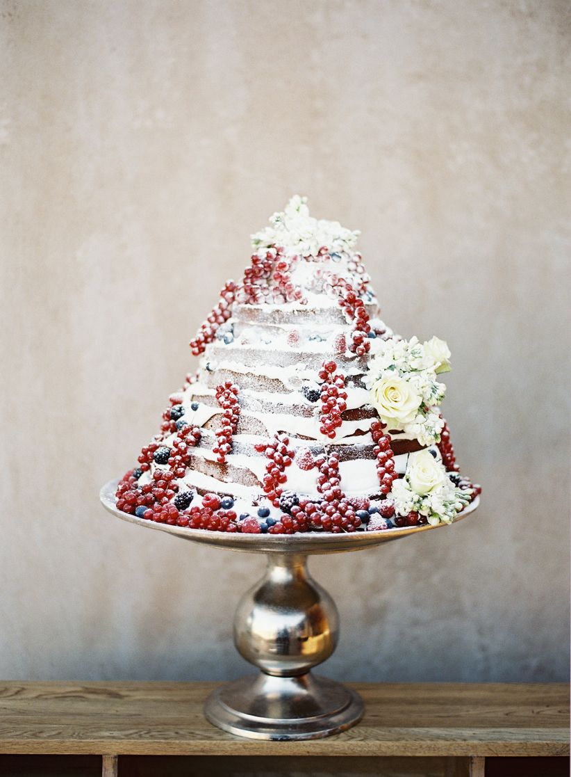 winter naked wedding cake with red berries