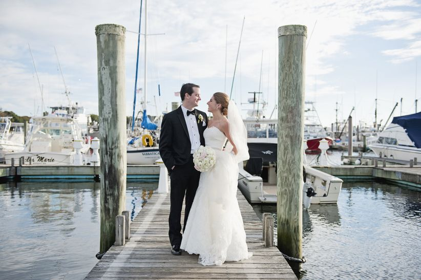 couple standing on pier in cape cod