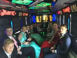 1Up'n Limousines and Party Buses 1