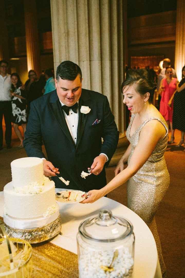 cake cutting in reception dress