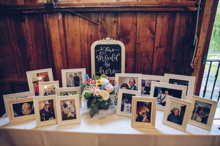 It's very common to have memorial tables at weddings. This is a picture of ours.