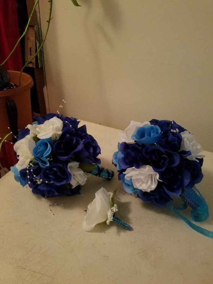 brides maids & grooms men( blue  & white silk roses)