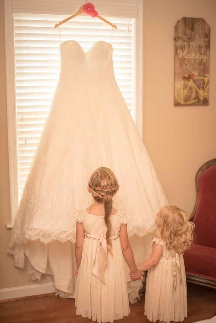 My daughters looking up at my dress