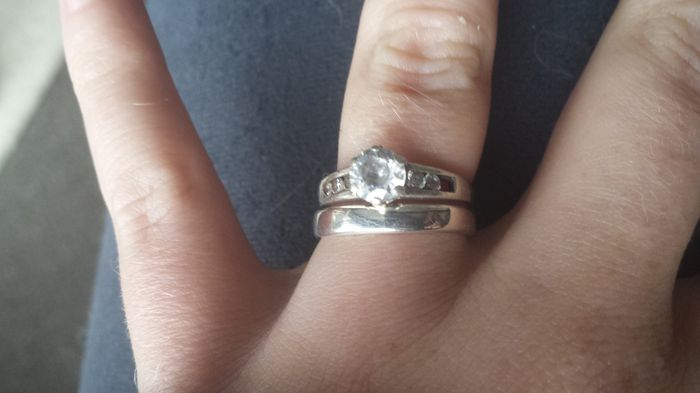 2ca4f0e13 ... missing stone and a split where they resized it and the other pic is  both the e ring and the wedding band, I don't think they would look good as  one.