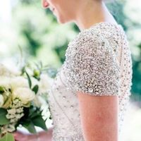 wedding gown with beaded bodice and sleeves
