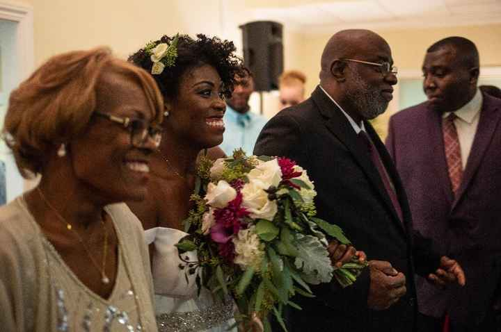 Mom, me and dad walking down the aisle!