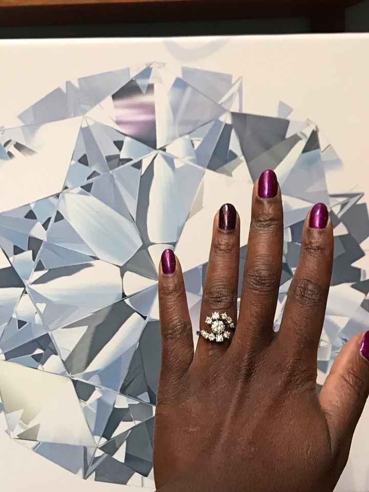 You can see the facet shape of this cut of diamond in the painting behind my hand