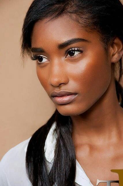 She has on lashes and a shimmery eye shadow and blush, still looks very natural glam